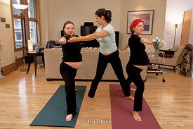 Pregnant woman doing yoga, Tribeca, New York