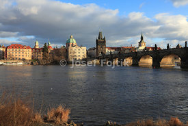 Monastery of the Knights of the Cross with a Red Star and Dome of the Church of Saint Francis Seraph on the Aleš Embankment and Charles Bridge on the Vltava River, Prague, Czech Republic, Europe