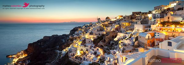 Panoramic of village of Oia at sunset, Santorini, Greece