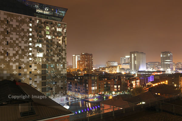 The Cube building and cityscape of Birmingham at night, West Midlands, England, UK