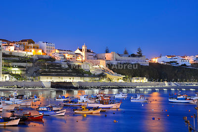 The fishing harbour of Sines at dusk. Portugal