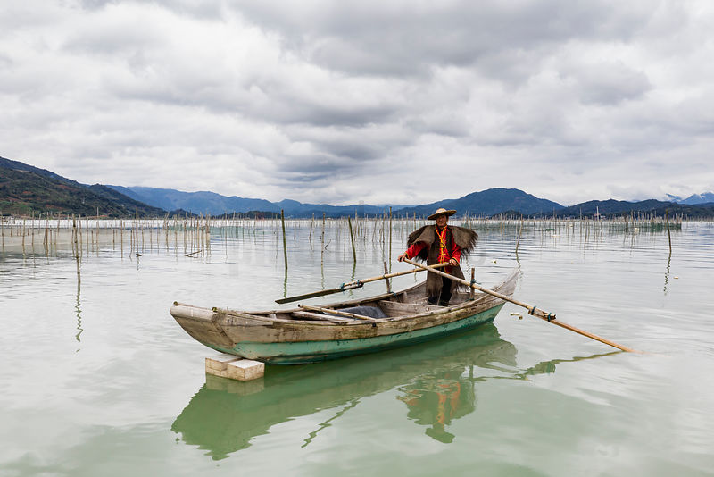 Fisherman Paddling between his Shrimp Nets