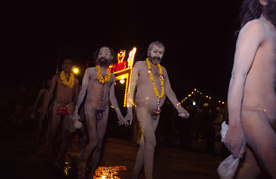 Naked, ash smeared Naga Saddhu march to bathe in the Ganges at the Ardh Kumbh Mela 1995, Allahbad, India