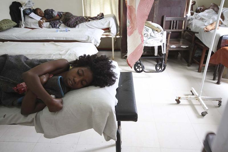 A young girl who survived the MV Spice Islander disaster lies in Mnazi Mmoja hospital, September 10, 2011. Of those on board, around 620 were rescued, with at least 40 of them suffering serious injuries.