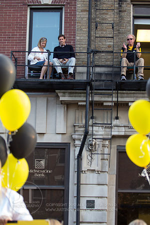 Spectators watch the University of Iowa homecoming Parade on Washington St in Iowa City on Friday September 28, 2012. (Justin Torner/Freelance)