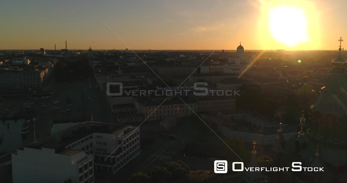 Helsinki Cityscape, Aerial Sideway View Around Uspetski Cathedral and Its Golden Cupole, Revealing the City, on a Sunny Summer Evening Dusk, in Helsingfors, Uusimaa, Finland