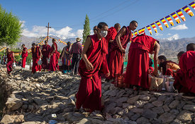 The buddhist monks get ready to serve tea to the crowd during a festival in Ladakh