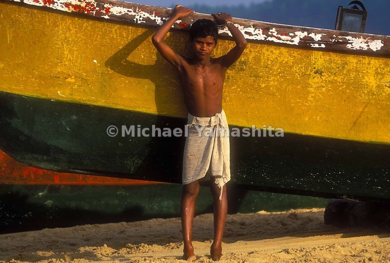 The young in the fishing villiages of Kerala dress simply and suitably.