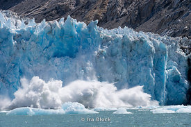 Ice calving off at Dawes Glacier, Endicott Arm, Southeast Alaska.  Sequence 6 of 11.