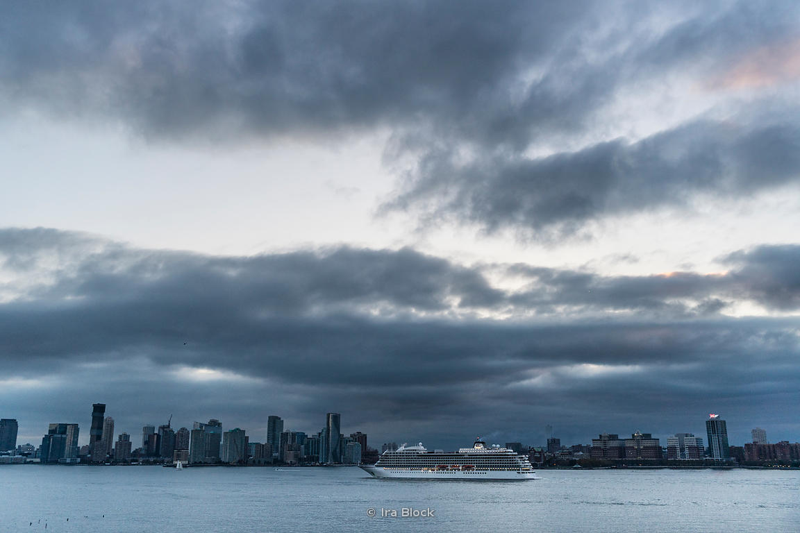 A cruise ship heads down the Hudson river to begin its voyage on the Atlantic.