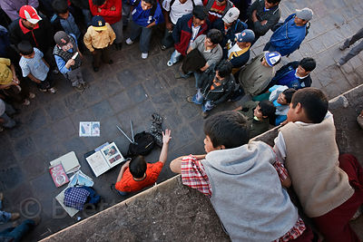 Children watch a comedy routine beng performed in a public plaza in Cusco, Peru. The shows are popular weekend fare.