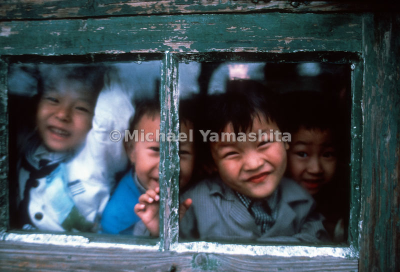 Young children look out the window at a Beijing primary school..China