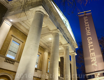 The Grand Pillars at the front of the floodlit Saatchi Gallery in Chelsea