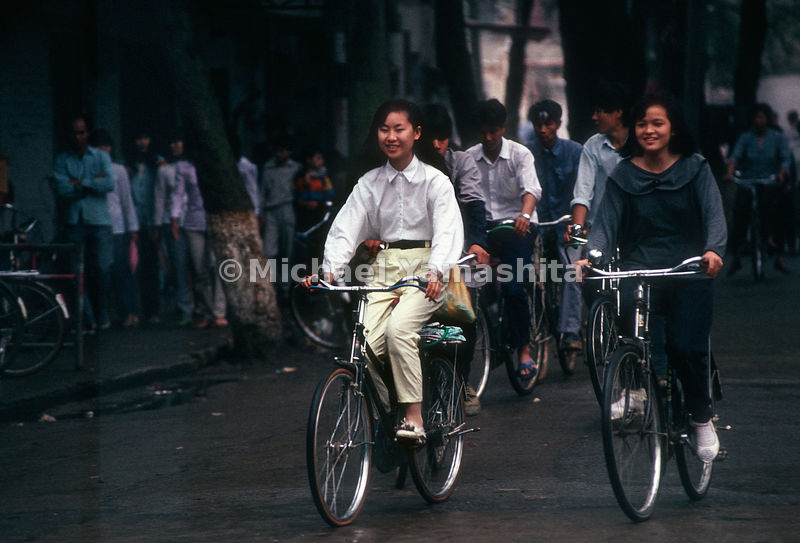 People ride bikes. Dongguan, China