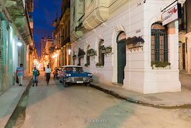 A street corner at night in Old Havana, Cuba.