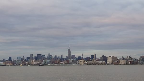 Wide Shot: Manhattan Skyline & Hudson River Blanketed With Low Cumulus (Day to Night)