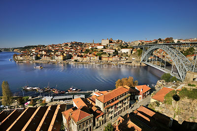 Aerial view of Oporto, capital of the Port wine, and the Ribeira district, UNESCO World Heritage Site. In the foreground the Rabelos boats and the Port wine cellars of Vila Nova de Gaia, Portugal