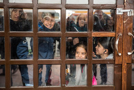 Kids waiting for a ferry at a terminal in Eminounu, Istanbul.