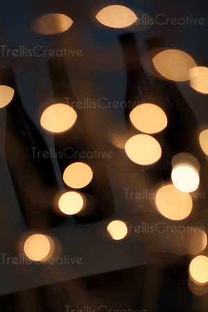 Light spots and bokeh over wine bottle shadows