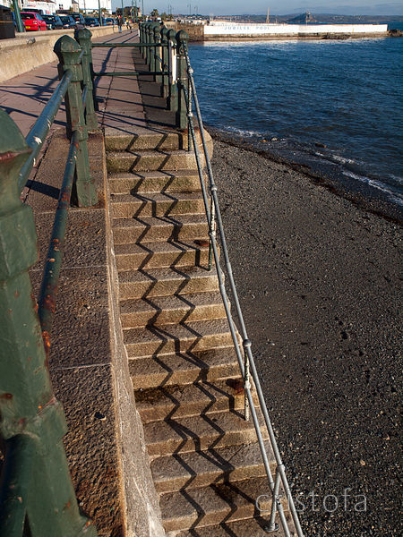 granite steps with zigzag shadow on Penzance seafront