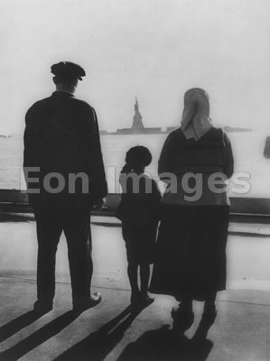 Immigrants view Statue of Liberty from Ellis Island