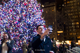 A tourist takes a selfie at the Bryant Park Winter Village in Manhattan, New York City