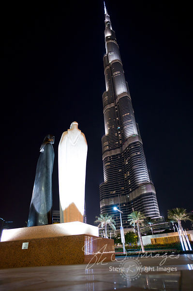 The Burj Khalifa and  'Together' Sculpture at Night - Dubai, United Arab Emirates