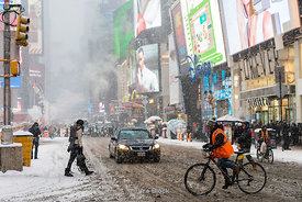 Traffic during a snow storm at Times Square in New York, USA.