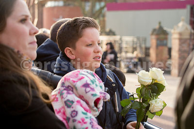Young Man Holding a Bunch of WHite Roses Waiting for the Arrival of Richard III's Cortege