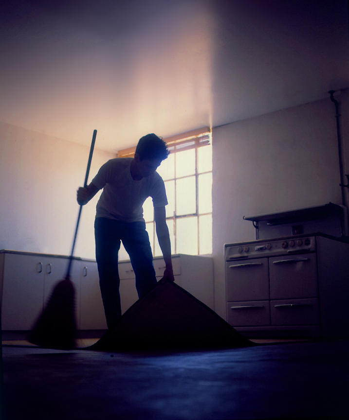 man_sweeping_secrets_under_