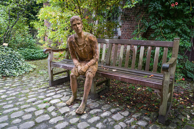 Sitting and engaging statue