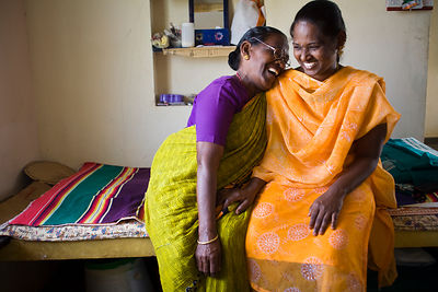 India - Cuddalore - An elderly resident shares a joke with her social worker in her room at the Tamaraikulam Elders' Village