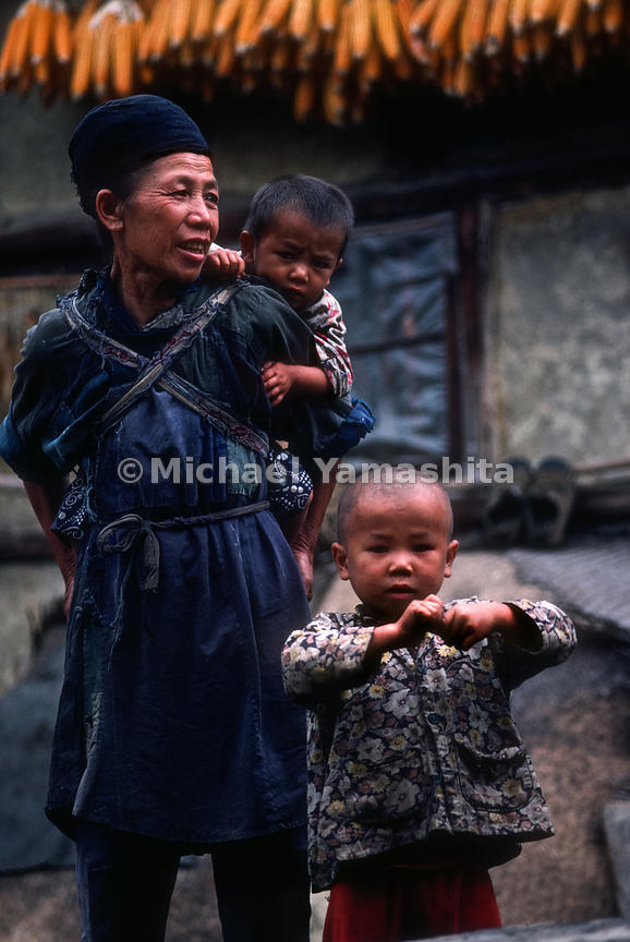 Portrait of a woman and two children in Buyi Village.Guiyang, Guizhou, China.
