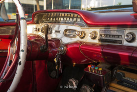 Detail of an antique red car in Havana, Cuba.
