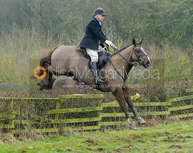 Paul Chenery jumping a hedge at Town Park Farm