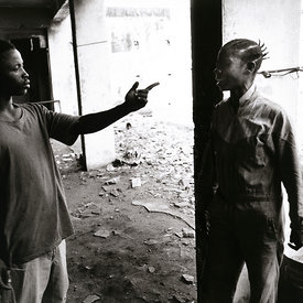 A former boy fighter argues with his girlfriend who he runs as a prostitute. Monrovia, Liberia
