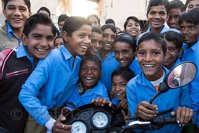 Schoolboys react with great excitement to seeing a foreigner visiting Chachiyawas village, Rajasthan, India