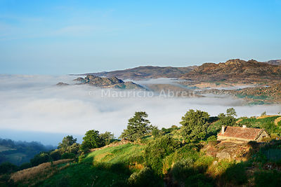 The fog surrounding the old and traditional village of Pitoes das Junias. Peneda Geres National Park. Portugal