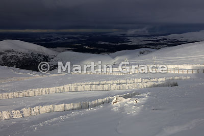 Late afternoon sun highlights the snow fencing below the Ptarmigan Restaurant, Cairn Gorm Mountain