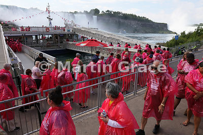 Tourists queueing to board the Hornblower Niagara Cruises' tourist vessel, Niagara Falls, Ontario, Canada with Maid of the Mist VII tourist vessel