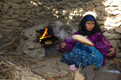 Bedouin woman baking bread, Siwa oasis, Egypt