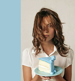 woman with blue cake on plate
