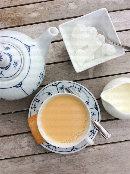 North German tea with cream and lump sugar in traditional porcelain