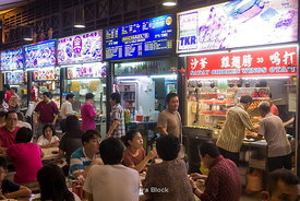 Street vendors at night in Newton Food Centre, Singapore.