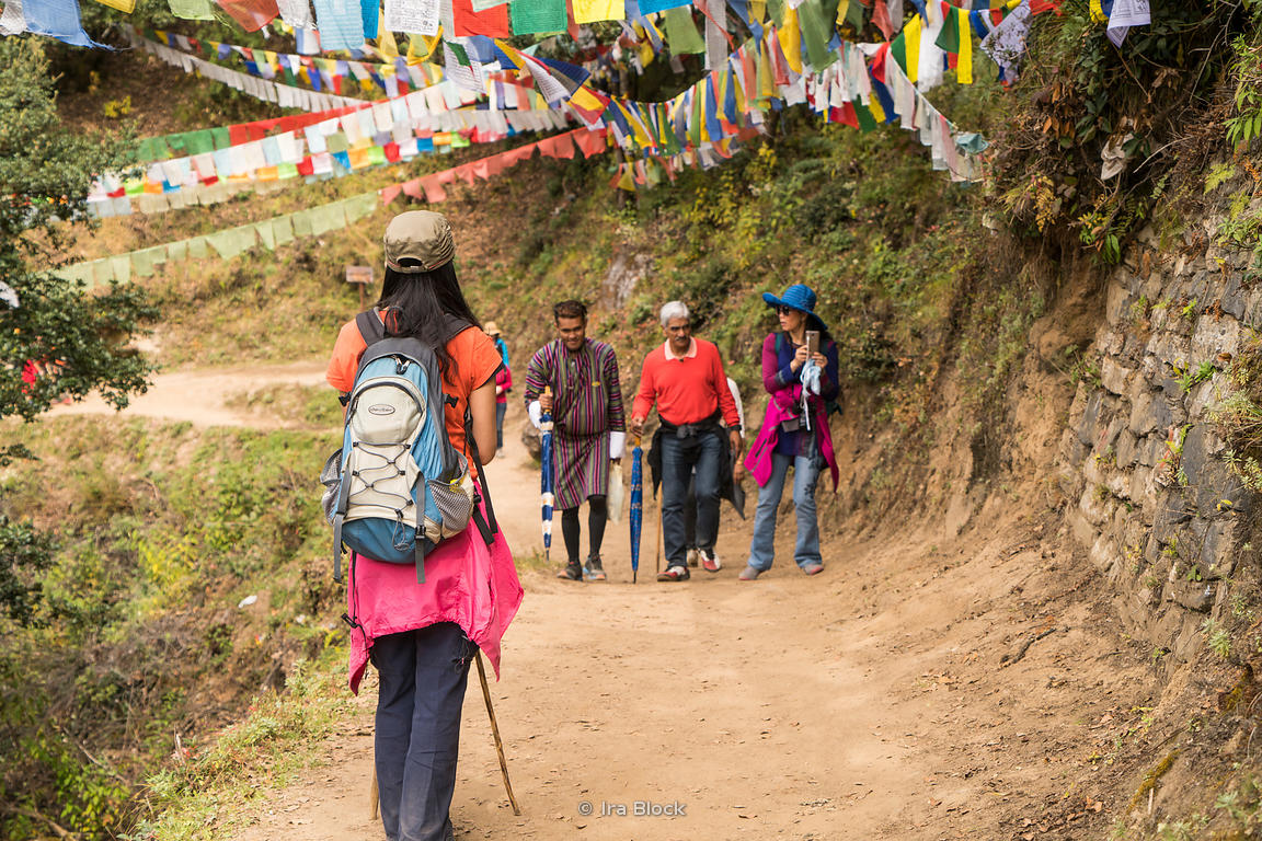 Tourist on the trail to the Tigers Nest in upper Paro valley, Bhutan.