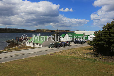 Typical Falkland Islands buildings with corrugated roofs and cladded exterior, and four-wheel-drive vehicles parked outside, Ross Road, Stanley, East Falkland, Falkland Islands