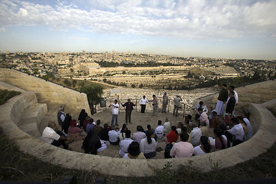 Israel - Jerusalem - A tour group looks at the Old City as seen from the Mount of Olives
