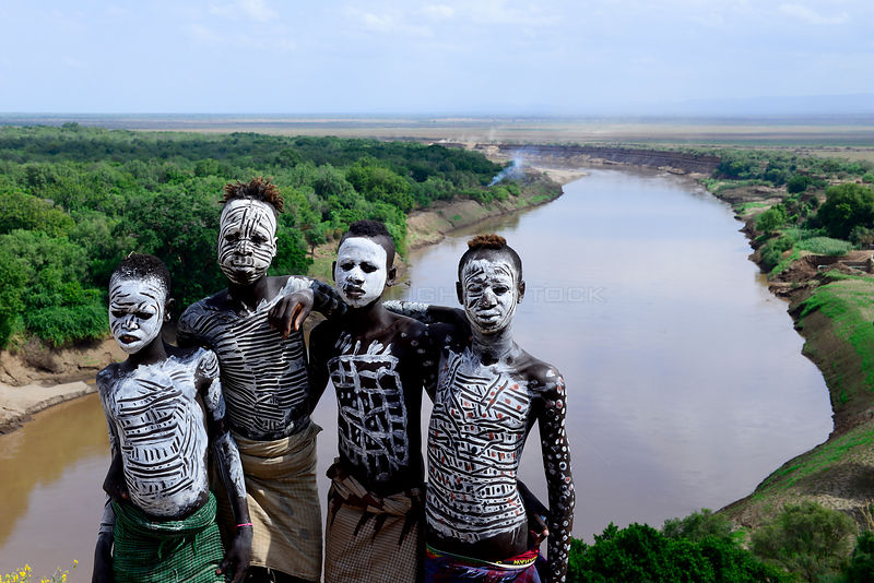 Karo boys with decorative skin painting. Karo tribe, Omo river, Ethiopia, November 2014