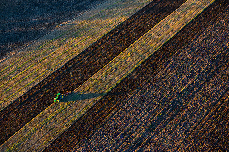 Aerial view of a tractor ploughing,  Vooremaa Landscape Reserve, Tartumaa, Estonia, October 2013.