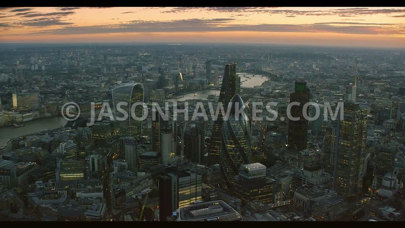 Aerial footage at dusk of the City of London, London.